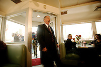 Democratic presidential hopeful Howard Dean, reacts to supporters as he enters Miss Katies Diner on a campaign stop in Milwaukee WI. 11, Feb. 2004 MilwaukeeWI.    EPA -Darren Hauck.