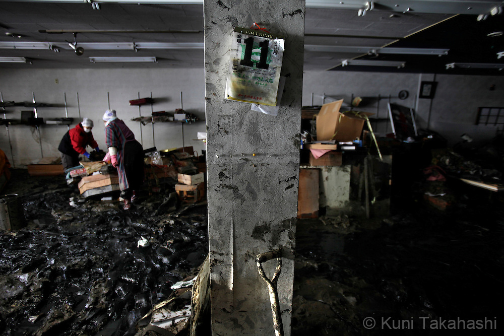 A calender shows March 11 in mud-filled Japanese kimono shop in Ishinomaki, Miyagi, Japan on April 1, 2011 after massive earthquake and tsunami hit northern Japan. More than 20,000 were killed by the disaster on March 11.<br /> Photo by Kuni Takahashi