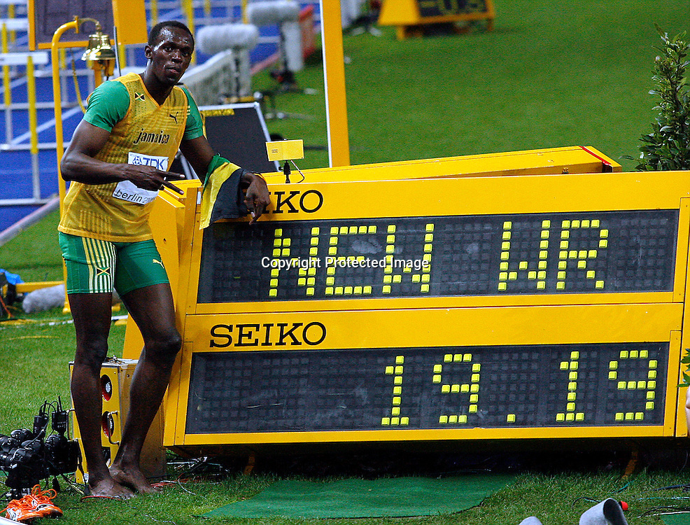 Usain Bolt of Jamaica celebrates after he won ahead of the competition in the men's 200 meters final during the 12th IAAF Athletic World Championships at the Olympic Stadium in Berlin, Germany, 20 August 2009. Photo: Wrofoto/PHOTOSPORT