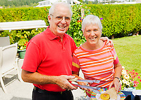 Mature couple portrait outside on their patio