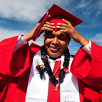 051713       Brian Leddy<br /> Cordell Growler adjusts his cap while getting ready for graduation ceremonies at Navajo Technical College Friday. Growler earned his electrical trades certificate.