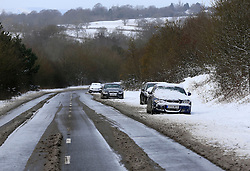 © Licensed to London News Pictures. 12/03/2013, Hayward Heath, UK.  Cars are seen abandoned by a snow covered road side near Hayward Heath, West Sussex, England, as roads are affected by snow fall, Tuesday, March 12, 2013. Photo credit : Sang Tan/LNP