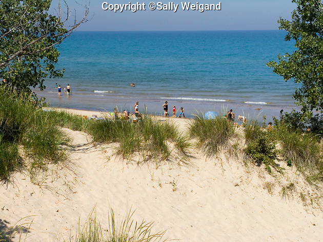 Lake Michigan, people on beach, high sand dunes