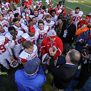 Smyrna eagles players celebrate after defending Salesianum 32-26 in overtime Saturday, Dec. 05, 2015 at Delaware Stadium in Newark.