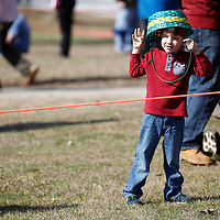 Thomas Wells | BUY at PHOTOS.DJOURNAL.COM<br /> Lyndon Melton, 4, of Tupelo turns his basket into a hat as he and and others can only find ways to pass the time before Saturday's Easter Egg Hunt at Ballard Park.