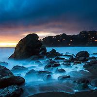 The setting sun fades into the horizon as the houses near Muir Beach prepare for night. © John McBrayer