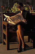 A business lady reads a 1992 edition of the Evening Standard whose headline reports on the 15% load rate after two days when Prime Minister John Major fought the Pound Crisis, in the City of London (the capital's financial district, aka The Square Mile), the capital's financial centre, on 18th September 1992, in London, England. Black Wednesday occurred in the United Kingdom on 16 September 1992, when John Major's Conservative government was forced to withdraw the pound sterling from the European Exchange Rate Mechanism (ERM) after it was unable to keep the pound above its agreed lower limit in the ERM.