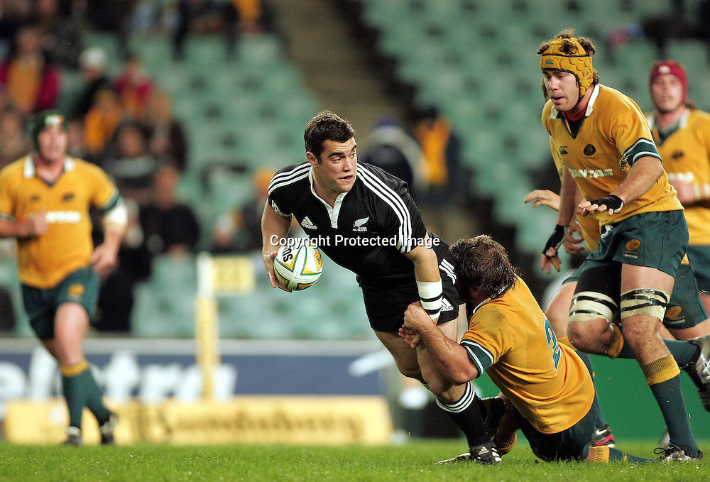 Corey Flynn tackled by Adam Freier during the  Match between the Australia A v Junior All Blacks at Aussie Stadium, Sydney on 1 July 2005. The Junior Blacks won the game 34-29. Photo: Paul Seiser ©Seiser Photography/PHOTOSPORT
