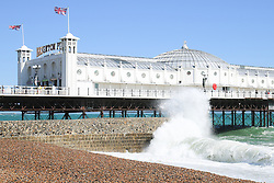 © Licensed to London News Pictures. 07/07/2015. Brighton, UK. strong wind and heavy waves are hitting major parts of the South Coast with few people visiting Brighton beach, today July 7th 2015. Photo credit : Hugo Michiels/LNP