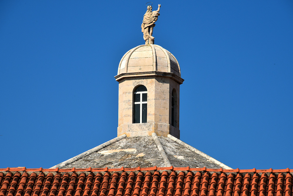 Cupola on Church of Saint Justine in Korčula, Croatia<br /> The statue on top of this cupola is the resurrected Christ. The church is dedicated to Saint Justine who was martyred for her Christian beliefs in 304 AD. Also spelled Saint Justina, she is the patron saint of Padua, northern Italy&rsquo;s oldest city which was founded in 1183 BC.  She is also the patroness of Venice. This Roman Catholic Church Sveta Justina was built just outside of the city walls in 1897.