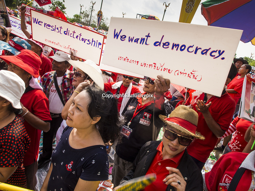 April 6, 2014 - Bangkok, Bangkok, Thailand - <br /> <br /> Red Shirts Rally in Bangkok Suburbs<br /> <br /> Red Shirts supporters at a pro government rally hold up signs protesting the Thai courts and military who they suspect of harboring anti-government factions. Red Shirts and supporters of the government of Yingluck Shinawatra, the Prime Minister of Thailand, gathered in a suburb of Bangkok this weekend to show support for the government. The Thai government is dealing with ongoing protests led by anti-government activists. Legal challenges filed by critics of the government could bring the government down as soon as the end of April. The Red Shirt rally this weekend was to show support for the government, which public opinion polls show still has the support of most of the electorate. <br /> &copy;Exclusivepix