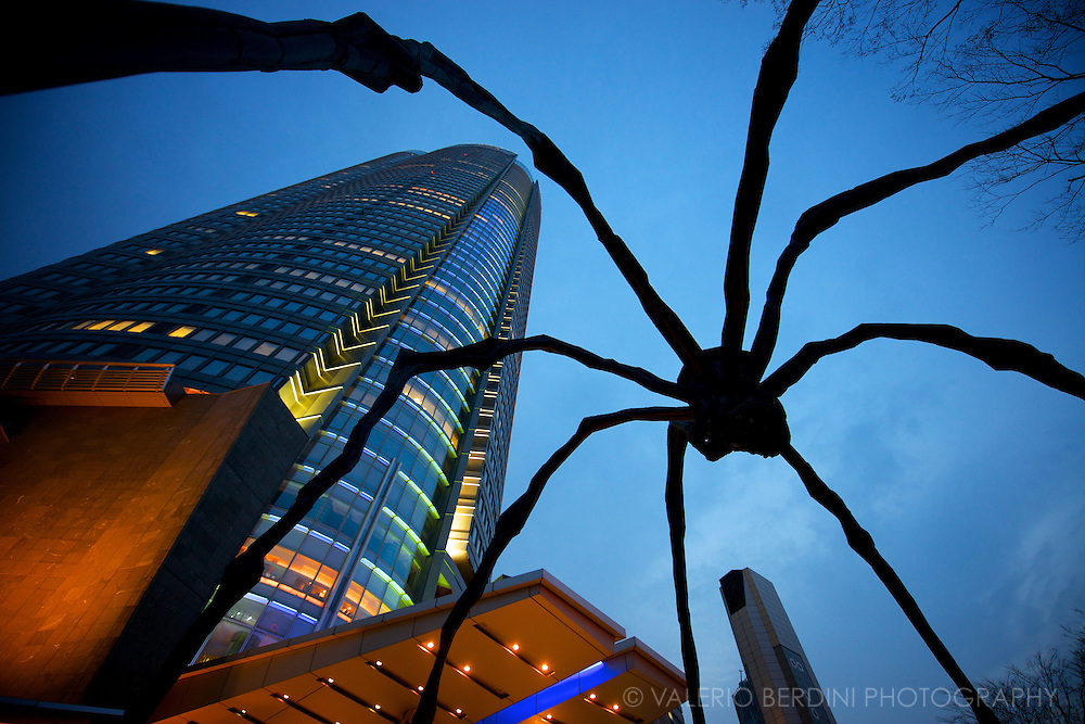 Maman, the giant bronze sculpture resembling a spider, by French-American artist Louise Bourgeois, in the copy installed in front of Mori Art museum sited at Roppongi Hills in Tokyo. Japan, 2013