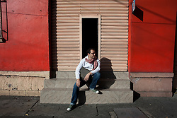 Emiliano Godoy stands on the street just around the corner from his office in the Roma neighborhood of Mexico City.