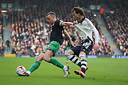 Bristol City striker and captain, Aaron Wilbraham (18) holding off Fulham defender, Fernando Amorebieta (45) during the Sky Bet Championship match between Fulham and Bristol City at Craven Cottage, London, England on 12 March 2016. Photo by Matthew Redman.