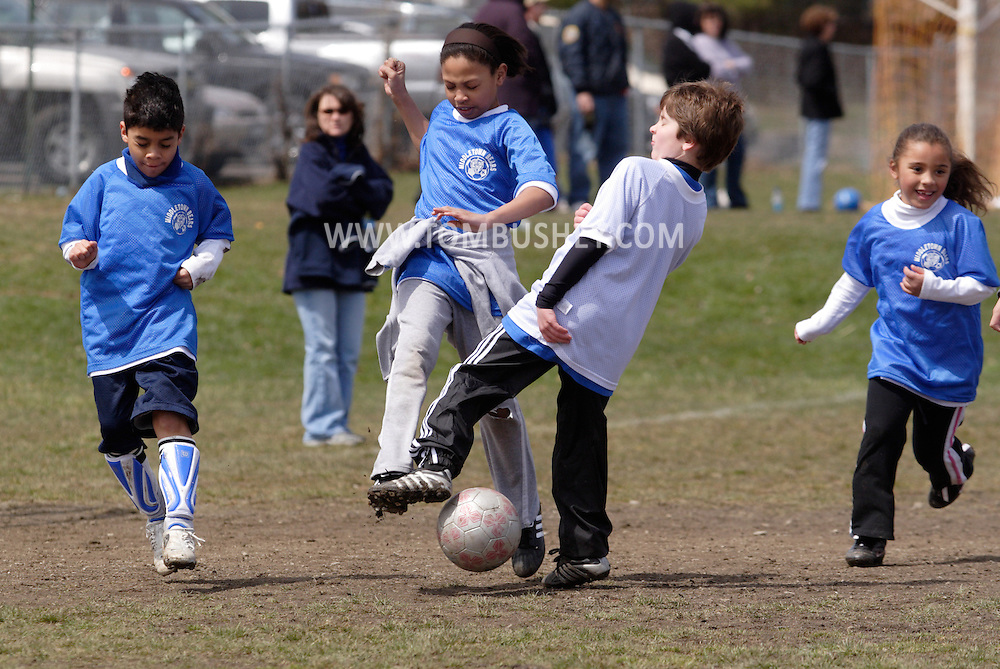 Middletown, NY - Children battle for the ball during Middletown Youth Soccer League practice at Watts Park on April 14, 2007..