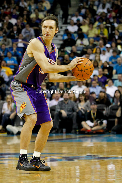 December 30, 2011; New Orleans, LA, USA; Phoenix Suns point guard Steve Nash (13) against the New Orleans Hornets during the a game at the New Orleans Arena. The Suns defeated the Hornets 93-78.   Mandatory Credit: Derick E. Hingle-US PRESSWIRE