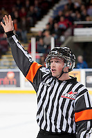 KELOWNA, CANADA - NOVEMBER 6: Colin Watt, referee, stands on the ice as the Kelowna Rockets play the Red Deer Rebels on NOVEMBER 6, 2013 at Prospera Place in Kelowna, British Columbia, Canada.   (Photo by Marissa Baecker/Shoot the Breeze)  ***  Local Caption  ***