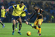 Oxford United defender Curtis Nelson (5) holds up Bradford City midfielder Mark Marshall (7) 0-0 during the EFL Trophy match between Oxford United and Bradford City at the Kassam Stadium, Oxford, England on 31 January 2017. Photo by Alan Franklin.