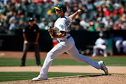 OAKLAND, CA - AUGUST 04:  Blake Treinen #39 of the Oakland Athletics pitches against the St. Louis Cardinals during the seventh inning at the RingCentral Coliseum on August 4, 2019 in Oakland, California. The Oakland Athletics defeated the St. Louis Cardinals 4-2. (Photo by Jason O. Watson/Getty Images) *** Local Caption *** Blake Treinen