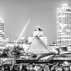 Milwaukee skyline at night panorama photo in black and white. Picture includes the Milwaukee lakefront, Milwaukee Art Museum, University Club Tower, and Northwestern Mutual Tower. Milwaukee is the largest city in Wisconsin Panorama photo ratio is 1:3 and image is high resolution.