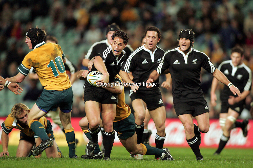 Luke McAlister about to offload with support from Claeb Ralph and Marty Holah during the  Match between the Australia A v Junior All Blacks at Aussie Stadium, Sydney on 1 July 2005. The Junior Blacks won the game 34-29. Photo: Paul Seiser ©Seiser Photography/PHOTOSPORT