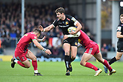 Ollie Devoto of Exeter Chiefs is tackled as he bursts forward during the Aviva Premiership match between Exeter Chiefs and Harlequins at Sandy Park, Exeter, United Kingdom on 19 November 2017. Photo by Graham Hunt.