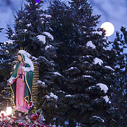 The moon rises during the Feast Our Lady of Guadalupe celebration annual two-day feast celebration of Mexico's patron saint. Believers from the Chicago area gather day and night to pay homage at the shrine.  Photography by Jose More