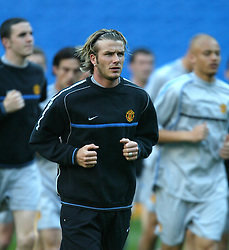 MADRID, SPAIN - Monday, April 7, 2003: Manchester United's David Beckham leads his team-mates in training at the Estadio Santiago Bernabeu ahead of his side's Champions League Quarter Final 1st Leg match with Real Madrid. (Pic by David Rawcliffe/Propaganda)