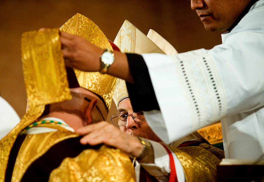 042309     Brian Leddy.Most Rev. Michael Sheehan, the Archbishop of Santa Fe, ordains Bishop James Wall as the new Bishop of the Catholic Diocese on Thursday at Sacred Heart Cathedral. Wall was appointed by Pope Benedict XVI to head the diocese.