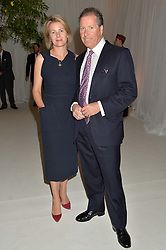 VISCOUNT & VISCOUNTESS LINLEY at a dinner hosted by Cartier in celebration of The Chelsea Flower Show held at The Hurlingham Club, London on 19th May 2014.
