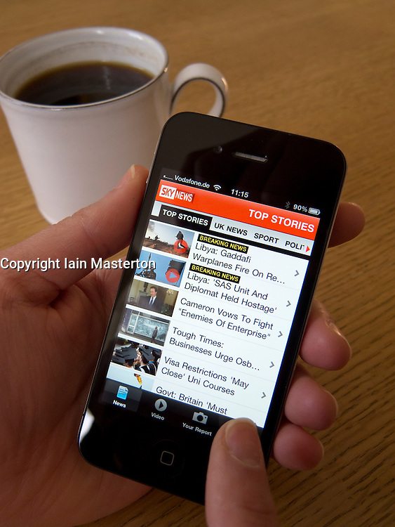 Reading Sky News  online with an Apple iphone 4G smartphone