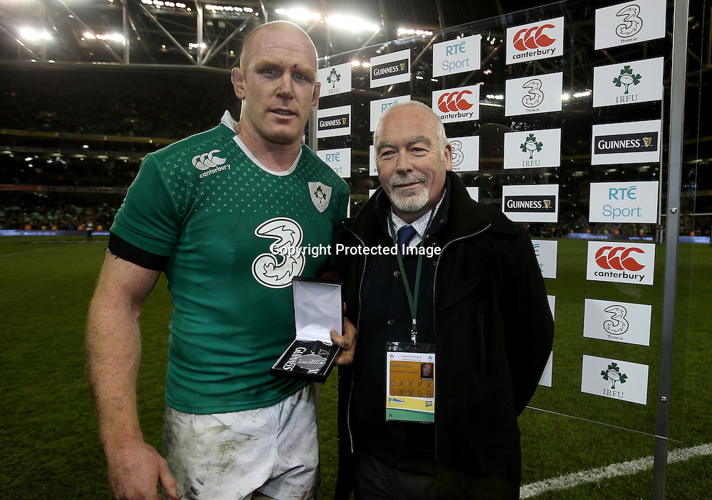 Guinness Series, Aviva Stadium, Dublin 22/11/2014<br /> Ireland vs Australia<br /> Ireland's Paul O'Connell receives the Guinness Series man of the match award from Peter Coyle <br /> Mandatory Credit &copy;INPHO/Dan Sheridan