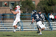 Wide Receiver number 12 jumps to make a catch for Cortland against Ithaca in the 2013 Cortaca Jug Game at Ithaca College.