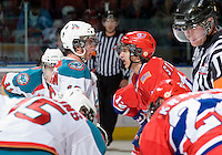KELOWNA, CANADA, JANUARY 4: Shane McColgan #18 of the Kelowna Rockts and Liam Stewart #11 of the Spokane Chiefs exchange words at the face off as the Spokane Chiefs visit the Kelowna Rockets on January 4, 2012 at Prospera Place in Kelowna, British Columbia, Canada. Stewart is the son of Sports Illustrated swimwear model Rachel Hunter and rock musician Rod Stewart. (Photo by Marissa Baecker/Getty Images) *** Local Caption ***