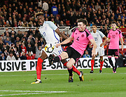John Souttar of Scotland clears from Tammy Abraham of England during the U21 UEFA EURO first qualifying round match between England and Scotland at the Riverside Stadium, Middlesbrough, England on 6 October 2017. Photo by Paul Thompson.