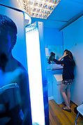 A young womAn in a self tanning salon, Brighton 2009