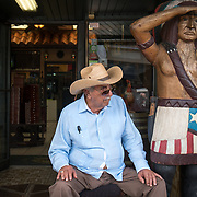MIAMI, FLORIDA, APRIL 22, 2017<br /> Pedro Bello, co-founder of the Cuba Tobacco Cigar Co. in Little Havana, sits in front of the store watching and greeting visitors. Many Cubans in Miami voted for Donald Trump who  will soon complete his first 100 days as United States President.<br /> (Photo by Angel Valentin/Freelance)