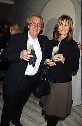 Art collector FRANK COHEN and MRS FRANK COHEN at a dinner hosted by Arnaud Bamber MD of Cartier, Amanda Sharp and Matthew Slotover Directors of the Frieze Art Fair to celebrate artists featured in the 2005 Frieze Art Fair Curatorial Programme at Nobu-Berkeley, 15th Berkeley Street, London on 21st October 2005.<br />
