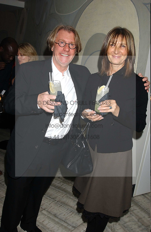 Art collector FRANK COHEN and MRS FRANK COHEN at a dinner hosted by Arnaud Bamber MD of Cartier, Amanda Sharp and Matthew Slotover Directors of the Frieze Art Fair to celebrate artists featured in the 2005 Frieze Art Fair Curatorial Programme at Nobu-Berkeley, 15th Berkeley Street, London on 21st October 2005.<br /><br />NON EXCLUSIVE - WORLD RIGHTS