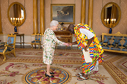 Queen Elizabeth II meets the High Commissioner of Ghana Papa Owusu-Ankomah as he presents his Letters of Credence during an audience at Buckingham Palace, London.