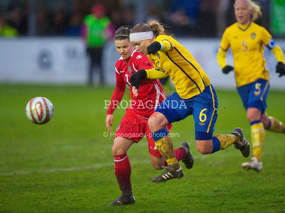 BROUGHTON, ENGLAND - Wednesday, March 31, 2010: Wales' Loren Dykes and Sweden's Sara Thunebro during the FIFA Women's World Cup 2011 Qualifying Group 8 match at the Airfeld. (Pic by David Rawcliffe/Propaganda)
