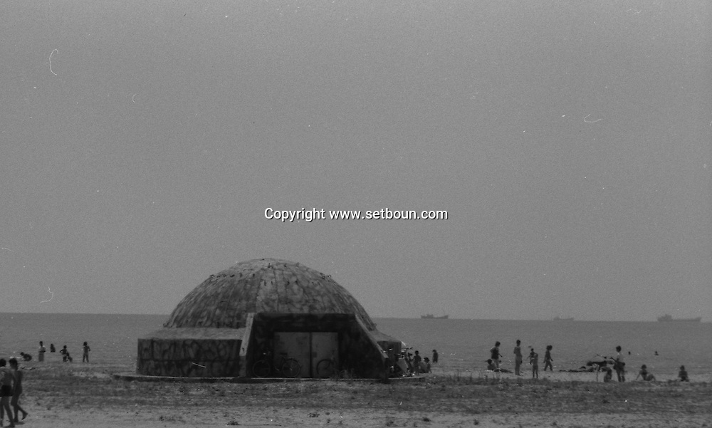 Abania in 1981 under the communist regime. blockhouses are every where, on the beaches, at the corner of the streets.: beach of DURRES.  +