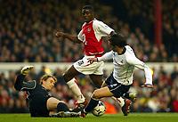 Photograph: Scott Heavey.<br />Arsenal v Tottenham Hotspur. FA Barclaycard Premiership. 08/11/2003.<br />Helder Postiga challenges Jens Lehman