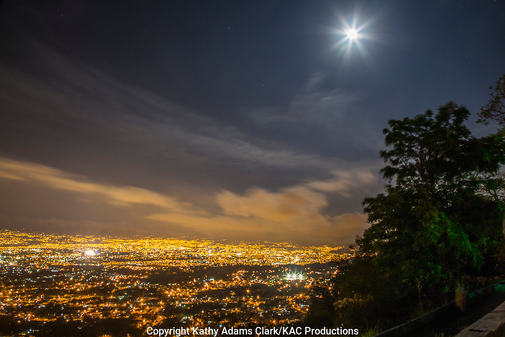 San Jose, Costa Rica, at night, full moon, moon rise, from an overlook over the city.
