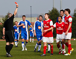 WIGAN, ENGLAND - Tuesday, March 29, 2011: Referee RJ West shows the red card to Arsenal's captain Ignasi Miquel during the FA Premiership Reserves League (Northern Division) match against Wigan Athletic at Robin Park. (Photo by Vegard Grott/Propaganda)