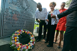 29 August 2013. Lower 9th Ward, New Orleans, Louisiana.<br /> Hurricane Katrina memorial 8 years later. <br /> Former councilwoman Cynthia Willard Lewis is handed a rose at the official memorial in remembrance of the day Hirricane Katrina swamped the community.<br /> Photo; Charlie Varley
