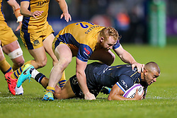 Jonathan Joseph of Bath Rugby is challenged by Will Hurrell of Bristol Rugby - Rogan Thomson/JMP - 20/10/2016 - RUGBY UNION - The Recreation Ground - Bath, England - Bath Rugby v Bristol Rugby - EPCR Challenge Cup.