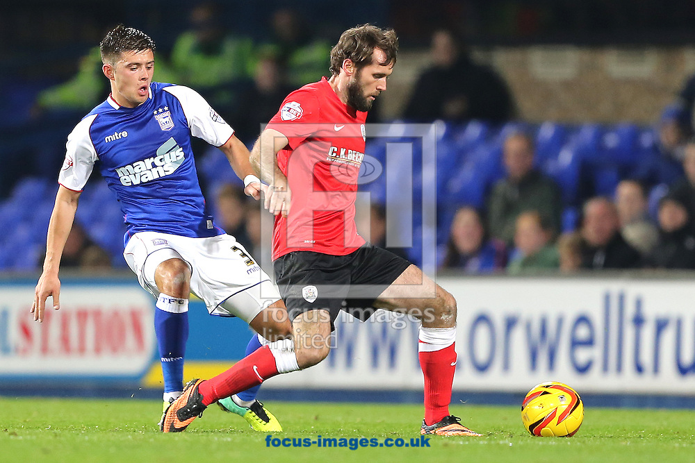 Picture by Richard Calver/Focus Images Ltd +447792 981244<br /> 01/11/2013<br /> Aaron Cresswell  of Ipswich Town and yJames O'Brien of Barnsley during the Sky Bet Championship match at Portman Road, Ipswich.