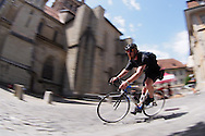 Picture by Andrew Tobin/Tobinators Ltd +44 7710 761829<br /> 04/08/2013<br /> A rider goes past the cathedral during the Cycle Messenger World Championships held in Lausanne, Switzerland. Started in 1993 by Achim Beier from Berlin, the championships are not only a sporting contest but an opportunity to unite friends and bicycle enthusiasts worldwide. The event comprises a number of challenges including a sprint, a track stand (longest time stationary on the bike), a cargo race where heavy loads are carried on special bikes, and the main race. The course winds through central Lausanne and includes bridges, stairs, cobbles, narrow alleyways and challenging hills. The main race simulates the job of a bike courier making numerous drops and pickups across the city. Riders need to check in at specific checkpoints, hand over their delivery and get a new one. The main race can take up to 4 hours for each competitor to complete.