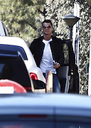 EXCLUSIVE MADRID, SPAIN, 2015, - ONLINE FEES £50 PER IMAGE<br /> <br /> Cristiano Ronaldo escapes to shoot a Christmas spot. The first to arrive were the models accompanying the football star. The last to appear hosted the spot, at the wheel of his new car. Christian, true to its stylish yet casual style chose jeans, white shirt and black shirt<br /> ©Exclusivepix Media